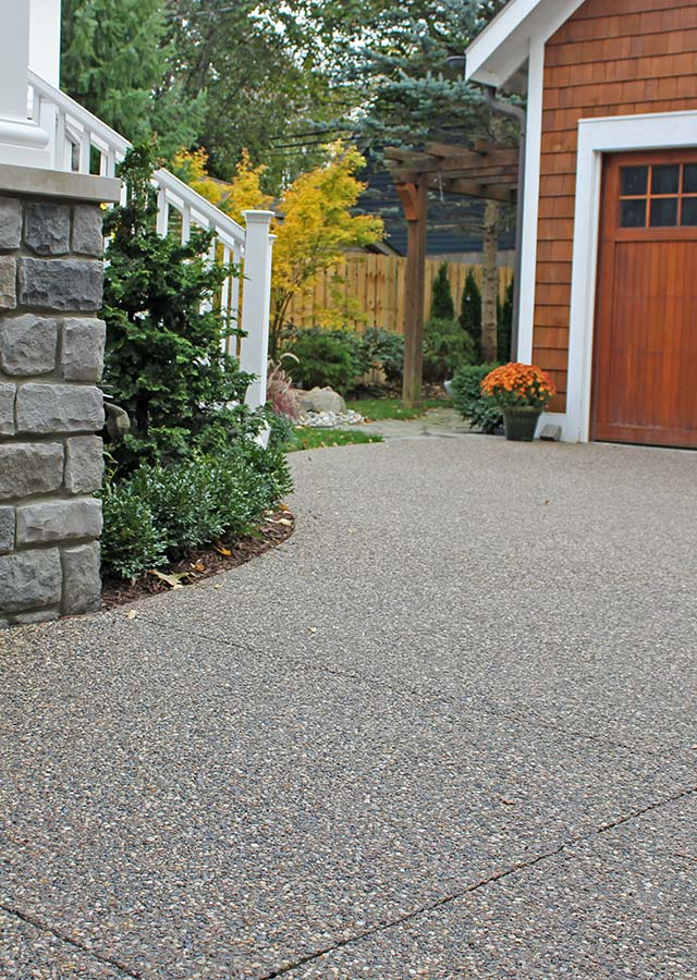 Exposed Aggregate Driveway with Stained Accents in Macomb County, Michigan