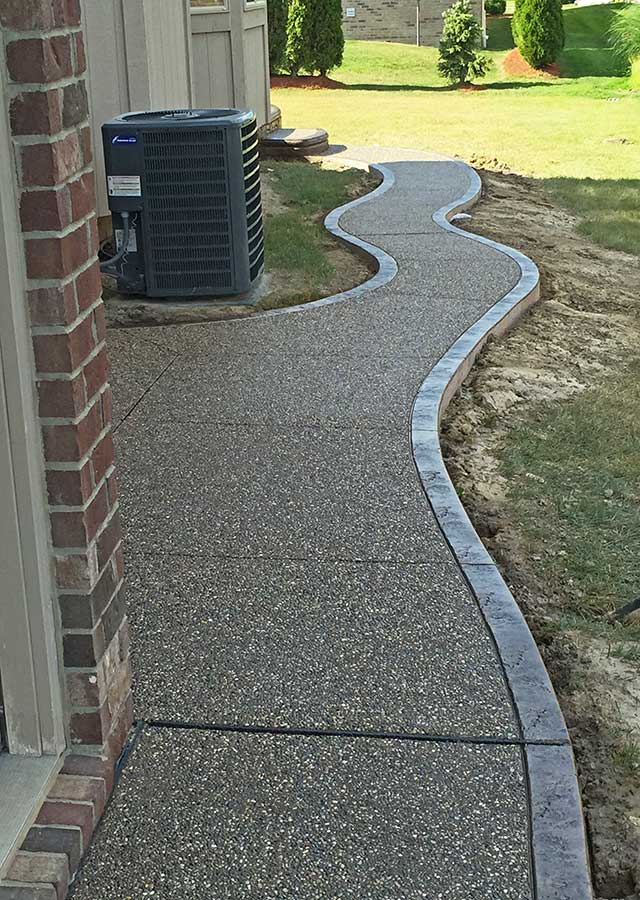 Curved Exposed Aggregate Walkway Contractor in Beverly Hills, Michigan