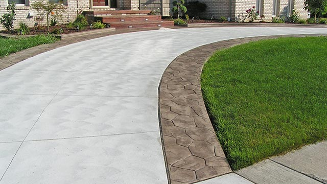 Plain Concrete Driveway with Stamped Concrete Ribbons in St. Clair Shores, Michigan