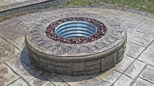 Stamped concrete patio with inset firepit