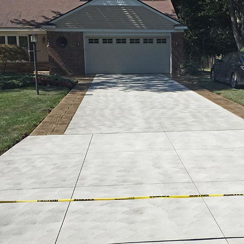 Stamped concrete patio with built-in fire pit